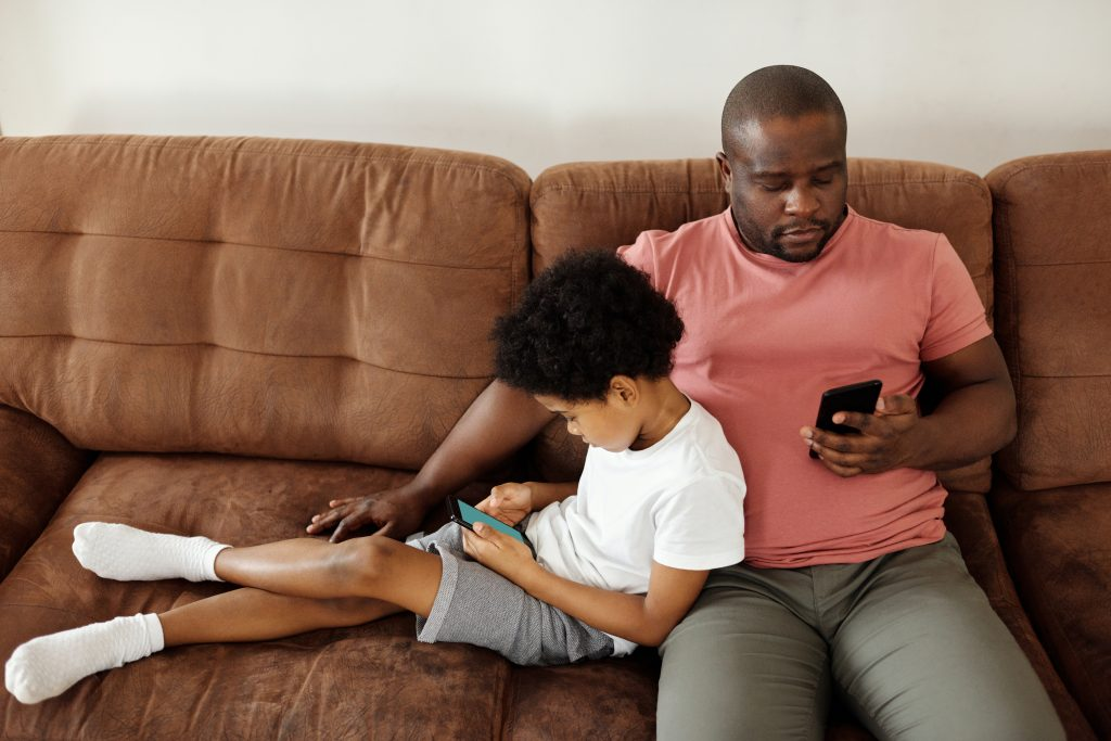 photo of dad and son on couch