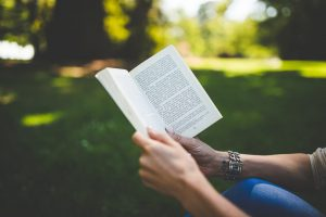 photo of person reading a book