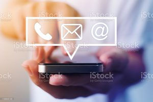 photo of phone with telephone, email and web icons